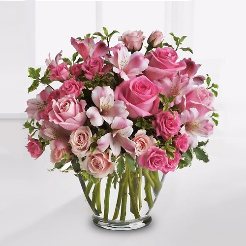 Send my dear one pink flowers to lebanon this beautiful abundant bouquet of soft pink roses and pink alstroemeria punctuated by fresh green pitta negra in a glass vase is a great way to make anyone mightylinksfo
