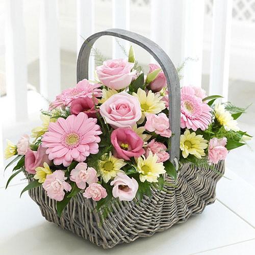 Send baby girl basket assorted pink flowers in a basket to saudi arabia baby girl basket mightylinksfo