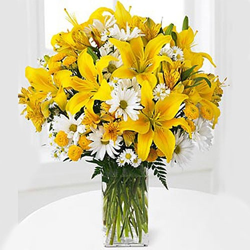 Send sunlit fields our assortment yellow flowers in a glass vase to charming yellow lilies yellow pompoms and white traditional daisies are beautifully arranged in a clear glass vase creating a rich floral mightylinksfo