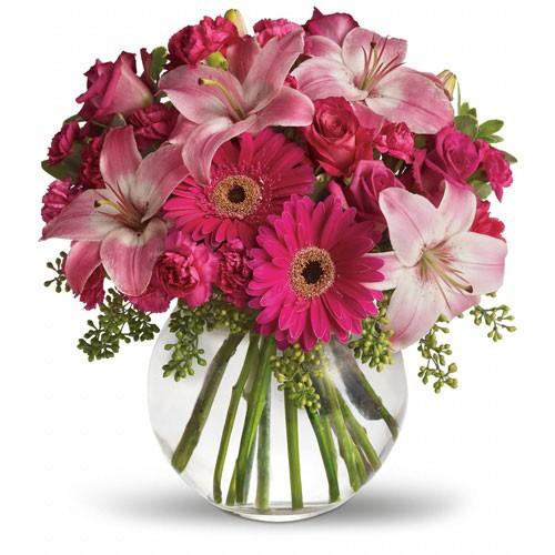 Send simply sweet mixed pink flowers in a vase to kuwait pretty pastels and delicate flowers make this a feminine classic for your sister friend or mother pink and purple lilies gerbera daisies mightylinksfo